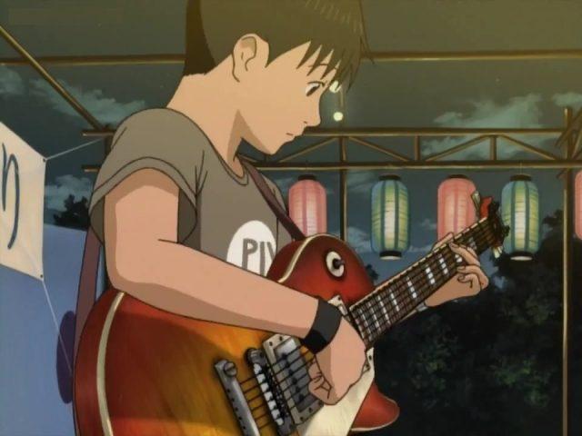 Koyuki tocando a guitarra